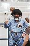 Payload Specialist Scully-Power in full flight suit with helmet (5134456669).jpg