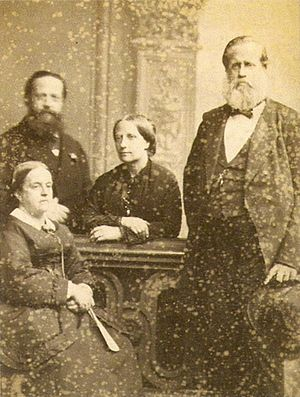 Princess Januária of Brazil - The Count and Countess of Aquila (seated, left) with her younger brother Emperor Pedro II (right) and his wife Empress Teresa Cristina, c. 1871.