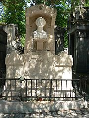 Tomb of Alfred de Musset in Père Lachaise Cemetery.