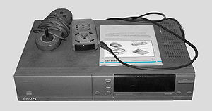 Gravis PC GamePad - CD-i with wired controller on top