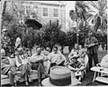 """Photograph of some of the reporters assembled in the garden of the """"Little White House"""" at Key West, Florida, for... - NARA - 200552.jpg"""