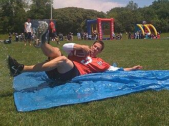 Cody Pickett - Pickett demonstrates a quarterback slide at a 2009 Argonauts training camp fan day.
