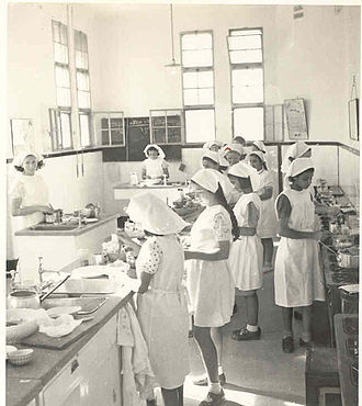 Girl - Cooking class at a girls' school in Jerusalem, c. 1936. Girls' upbringing and education were traditionally focused on preparing them to be future wives.