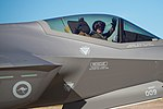 Pilot of A35-009 waving before departing Luke AFB for Australia.jpg