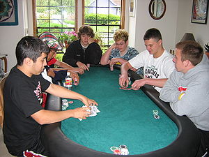 Poker tournament - A home poker tournament in progress.