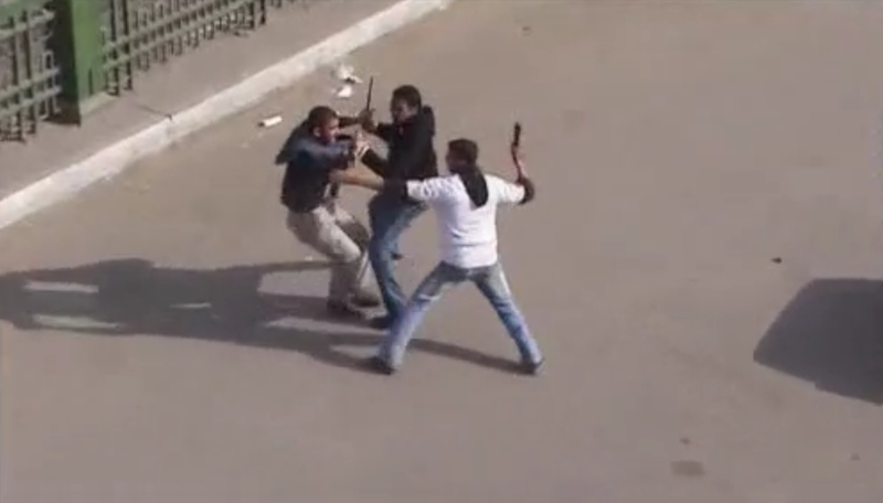 File:Police in civilian cloth beating a protester in Cairo 1.png
