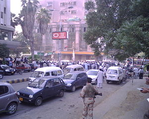 Lawyers' Movement - Policemen look on as lawyers gather in a pro-judiciary protest outside the Karachi Press Club on 5 November 2007.
