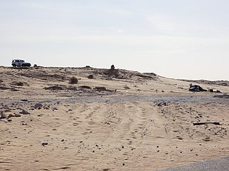 Western Sahara - A MINURSO car (left), and a post of the Polisario Front (right) in 2017 in southern Western Sahara