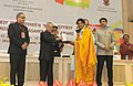 """Pranab Mukherjee presenting the Rajat Kamal Award for Best Narration Voice over """"Nitya Kalyani – Oru Mohiniyattam Patham"""" in Non Feature Films Section to the Narrator, Ms. Devi S., at the 62nd National Film Awards Function.jpg"""
