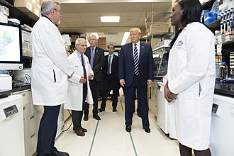 March 3: President Trump and Anthony Fauci visit the Vaccine Research Center and the Viral Pathogenesis Laboratory at the National Institutes of Health. President Trump at the National Institute of Health (49618032306).jpg