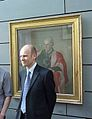 Prof Oliver Jensen in front of the portrait of Sir Horace Lamb.jpg