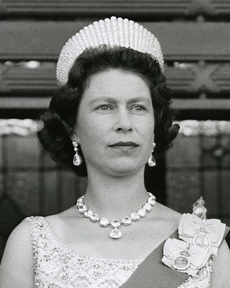 Elizabeth II's jewels - Elizabeth wearing the Coronation Earrings and matching necklace at the opening of the New Zealand parliament in 1963. She also wore the Kokoshnik Tiara.