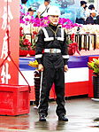 ROCMP with Rain Coat in Front of Chiayi AFB Reviewing Stand 20120811.jpg