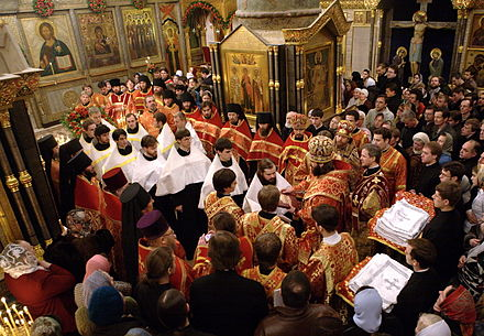 Tonsuring of readers in a seminary by a Russian Orthodox bishop. The readers being ordained are wearing the short phelon (in white). Reader ordination.jpg