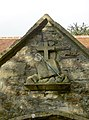 Relief on the gable of the south porch of St Martin's parish church, North Stoke, Somerset.jpg