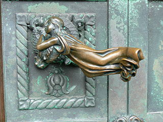 Door handle in form of a girl