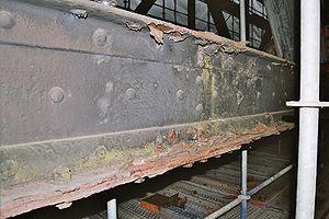 I-beam - Rusty riveted steel I-beam