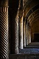 Rows of spiral stone pillars in vakil mosque.jpg
