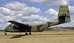 Twin-engined military cargo plane parked on airfield