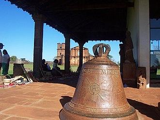 Ruins of São Miguel das Missões - Old church bell and native art in the Missions Museum, São Miguel das Missões.
