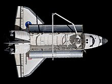 STS-133 Space Shuttle Discovery after undocking 3 (cropped).jpg