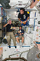 STS-134 Mark Kelly, Roberto Vittori and Greg Chamitoff during a break in the Unity node.jpg