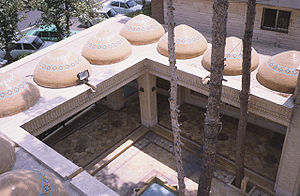 Sahn - Small sahn (courtyard) of a mosque in Tehran, with a howz (fountain pool) and domed riwaq.