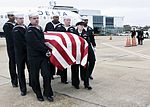 Sailors carry the remains of Petty Officer 1st Class Jim Johnston at the Jackson-Evers International Airport. (30641729104).jpg