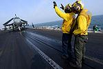Sailors direct an EA-6B aboard USS John C. Stennis..jpg
