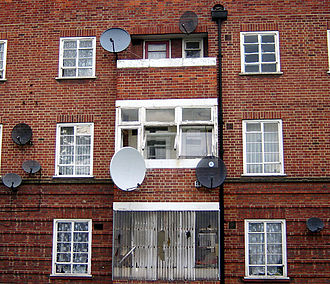 Television in the United Kingdom - Satellite dishes on a wall in Hackney, London. The small oval dishes are most likely being used for viewing British services, and are known as Minidishes. The larger dishes are most likely being used for viewing satellite services from outside the UK.
