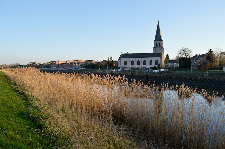Schellebelle's main church - the Sint-Jan Onthoofdingkerk - as seen from across the Scheldt on a very summer-like March evening in 2014.