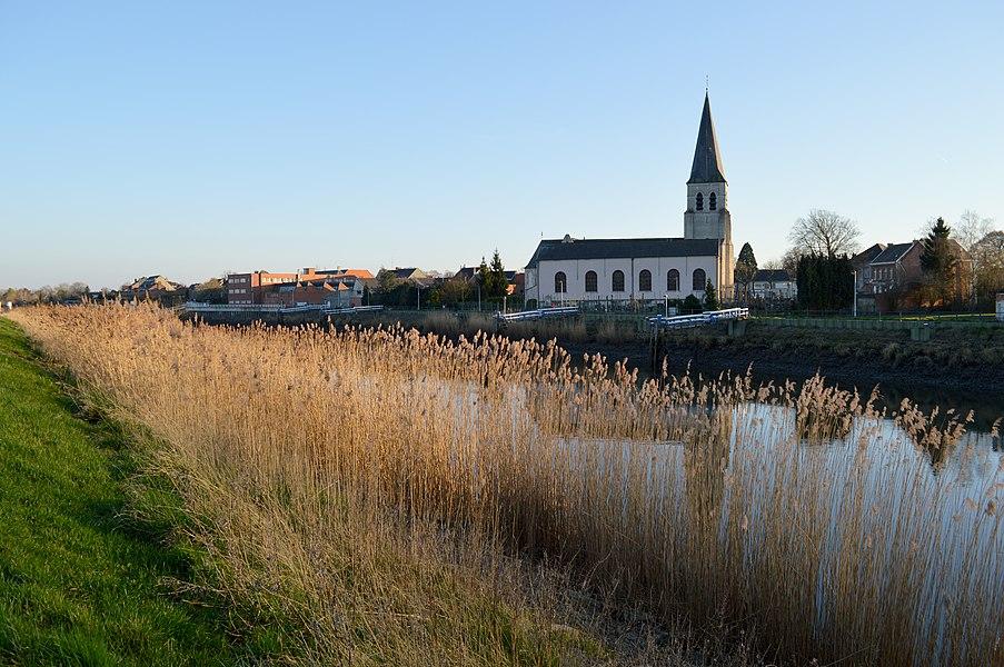 Schellebelle's main church - the Sint-Jan Onthoofdingkerk - as seen from across the Scheldt on a very summer-like March evening in 2014.