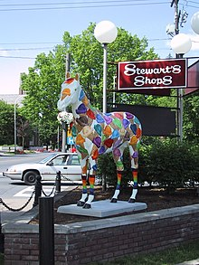 Life-sized fiberglass horse, decorated with multicolored ice-cream cones
