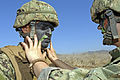 Seaman Recruit Michael Torres has his face painted to help camouflage him during a field training exercise at Camp Pendleton, Calif., on Nov 6, 2012 121106-N-GW695-031.jpg