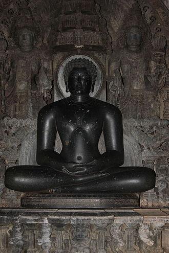 Shantinatha - Seated image of Shantinatha with old Kannada inscription (1200 A.D.) engraved on the pedestal in Shantinatha Basadi, Jinanathapura