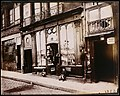 "Shop front of ""Courone d'or,"" Quai Bourbon MET DT1650.jpg"