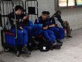 Sleeping security guards on Man Lok Street, Hung Hom, Kowloon, Hong Kong.jpg