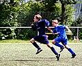 Sprint von zwei fussballspielern.JPG