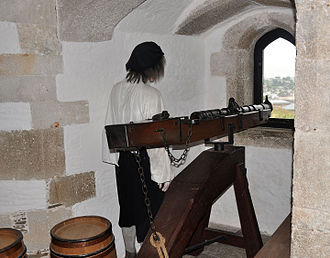 St Mawes Castle - Replica 16th-century iron breech loader, in the Henrician central tower