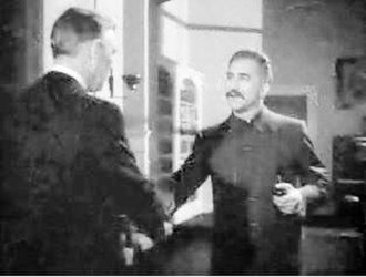 Mission to Moscow - Joseph Stalin (Manart Kippen) greets U.S. ambassador Joseph E. Davies (Walter Huston) in Mission to Moscow.