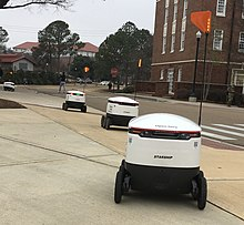 A line of Starship Technologies delivery robots at the University of Mississippi