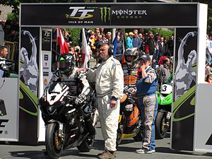 Motorcycle racing - Competitors line up at the start of the 2010 Senior TT race. This current form of road racing differs from others as it takes the form of a Time Trial but other historic TT events have differed using mass-starts and Le Mans starts