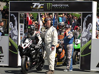 Isle of Man TT - Competitors line up at the start of the 2010 Senior TT race