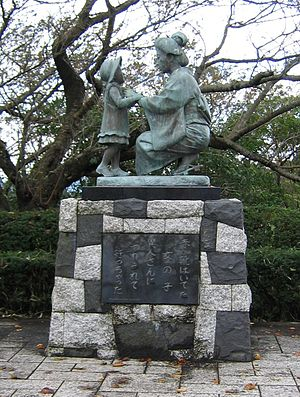 "Akai Kutsu - Image: Statue featuring ""girl in red shoes"""