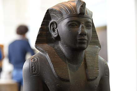 Statue of Ramesses IV, nomen and prenomen cartouches on shoulders, currently housed in the British Museum Statue of Ramesses IV, nomen and prenomen cartouches on shoulders, currently housed in the British Museum.jpg