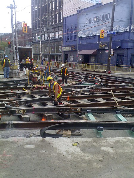 Via Wikipedia - Streetcar track reconstruction at Bathurst Street and Queen Street.