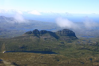 Assynt - Suilven from the air, showing the steep-sided mountain slopes and rough moorland landscape typical of Assynt.