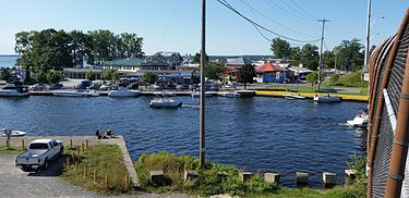sylvan beach new york with amusement park in near background erie canal in the foreground and oneida lake in the distant background