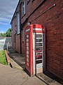 Telephone box next to the Post Office in Billingshurst, West Sussex England.jpg