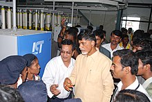 Chandrababu naidu with factory workers in textile industry